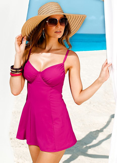 women's swim dresses Bring some sass and style to the shoreline with our wide variety of swim dresses. Get as much coverage as you want with high-neck and long skirted swim dresses or sexier coverage with plunging necklines and shorter hemline.